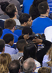 Drake sits in the crowd during the NCAA National Championship vs. UConn at the AT&T in Arlington, Tx., on Monday, April 7, 2014. Photo by Eleanor Hasken | Staff