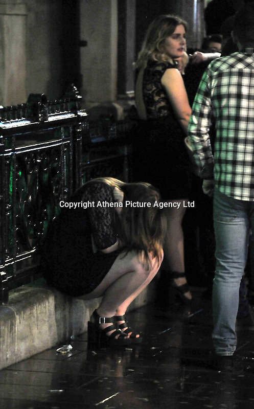 Pictured: A woman sits on the floor in the early hours of New Year's Day. Sunday 01 January 2017<br />Re: Revellers out celebrating the New Year in the pub and club on Wind Street Swansea