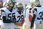 Torrance, CA 10/06/11 - Kevin Cavender (Peninsula #78), Ashton Jones (Peninsula #58) and Alex Asawa (Peninsula #35) in action during the Peninsula vs South Torrance Frosh football game.