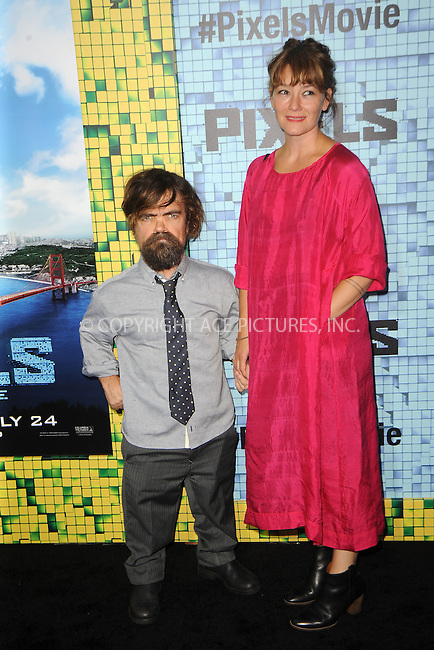 WWW.ACEPIXS.COM<br /> July 18, 2015 New York City<br /> <br /> Peter Dinklage and Erica Schmidt attending the 'Pixels' Premiere at Regal E-Walk on July 18, 2015 in New York City.<br /> <br /> Please byline: Kristin Callahan/ACE <br /> <br /> <br /> Tel: (646) 769 0430<br /> e-mail: info@acepixs.com<br /> web: http://www.acepixs.com