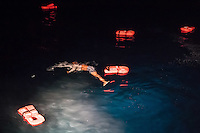 Die Sea Watch-2 Crew war am Freitag den 21. Oktober 2016 in den fruehen Morgenstunden waehrend ihrer 13. SAR-Mission vor der libyschen Kueste zu einer Position ausserhalb der 12 Meilenzone gerufen worden. Es war ein Fluechtlingsschlauchboot gesichtet worden. Als die Sea Watch-2 dort eintraf sah sie ca. 150 Menschen zusammengepfercht in einem ueberfuellten Schlauchboot sitzen. Eine Versorgung der Menschen auf dem Fluechtlingsschlauchboot mit Rettungswesten durch die Rettungs Boote der Sea Watch-2 wurde von der libyschen Kuestenwache unterbunden. Ein Soldat der Kuestenwache enterte das Schlauchboot vom Bug und machte sich dann an dem Aussenbordmotor zu schaffen. Auf dem Weg dahin schlug und trat er die Gefluechteten ein. Nach einigen Minuten entfernte sich das Boot der Kuestenwache. Dann verlor der Bug des Schlauchbootes seine Luft und es brach Panik bei den Gefluechteten aus. Sie sprangen in das Wasser und versuchten zum Schiff Sea Watch-2 zu gelangen. Die Crew warf ihnen Schwimmwesten und Rettungsringe zu, die Besatzungen der Rettungsboote der Sea Watch-2 zogen Menschen aus dem Meer, dennoch sind bis zu 30 Menschen ertrunken. Vier Ertrunkene konnten von der Sea Watch geborgen werden.<br /> Im Bild: Ein lebloser Koerper treibt im Wasser.<br /> 21.10.2016, Mediterranean Sea<br /> Copyright: Christian-Ditsch.de<br /> [Inhaltsveraendernde Manipulation des Fotos nur nach ausdruecklicher Genehmigung des Fotografen. Vereinbarungen ueber Abtretung von Persoenlichkeitsrechten/Model Release der abgebildeten Person/Personen liegen nicht vor. NO MODEL RELEASE! Nur fuer Redaktionelle Zwecke. Don't publish without copyright Christian-Ditsch.de, Veroeffentlichung nur mit Fotografennennung, sowie gegen Honorar, MwSt. und Beleg. Konto: I N G - D i B a, IBAN DE58500105175400192269, BIC INGDDEFFXXX, Kontakt: post@christian-ditsch.de<br /> Bei der Bearbeitung der Dateiinformationen darf die Urheberkennzeichnung in den EXIF- und  IPTC-Daten nicht entfernt werden, diese sind in digitalen