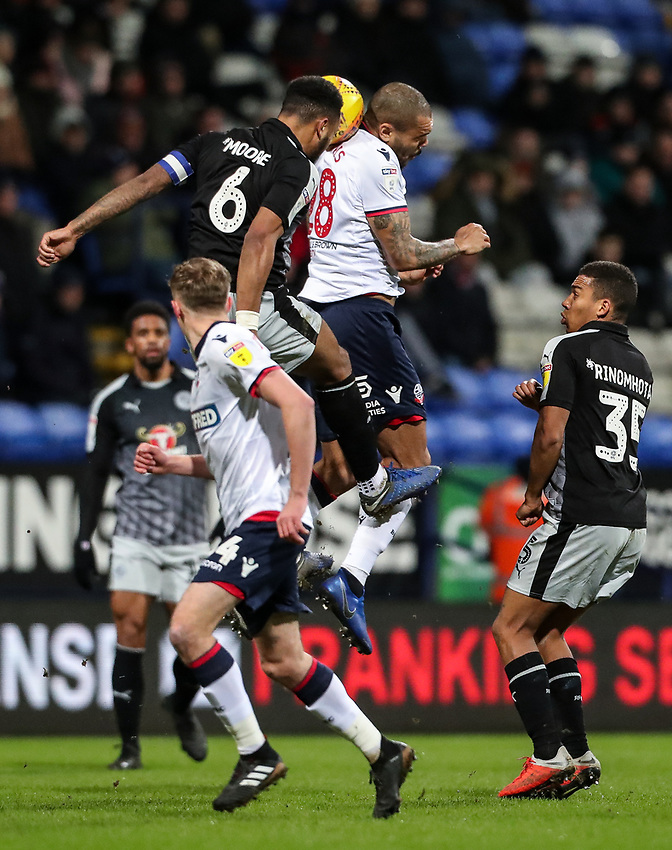 Bolton Wanderers' Josh Magennis competing with Reading's Liam Moore  <br /> <br /> Photographer Andrew Kearns/CameraSport<br /> <br /> The EFL Sky Bet Championship - Bolton Wanderers v Reading - Tuesday 29th January 2019 - University of Bolton Stadium - Bolton<br /> <br /> World Copyright © 2019 CameraSport. All rights reserved. 43 Linden Ave. Countesthorpe. Leicester. England. LE8 5PG - Tel: +44 (0) 116 277 4147 - admin@camerasport.com - www.camerasport.com
