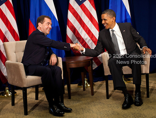 United States President Barack Obama, right, shakes hands with President Dmitry Medvedev of Russia, left, during the Asia-Pacific Economic Cooperation (APEC) at the Hale Koa Hotel  in Honolulu, Hawaii on Saturday, November 12, 2011..Credit: Kent Nishimura / Pool via CNP