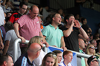 FAO SPORTS PICTURE DESK<br /> Pictured: Disappointed QPR supporters vent their anger towards their team's players as they leave the stands early. Saturday 18 August 2012<br /> Re: Barclay's Premier League, Queens Park Rangers v Swansea City FC at Loftus Road Stadium, London, UK.