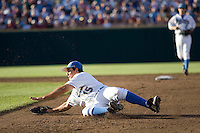 UCLA 1B Justin Uribe makes an error in Game One of the NCAA Division One Men's College World Series Finals on June 28th, 2010 at Johnny Rosenblatt Stadium in Omaha, Nebraska.  (Photo by Andrew Woolley / Four Seam Images)