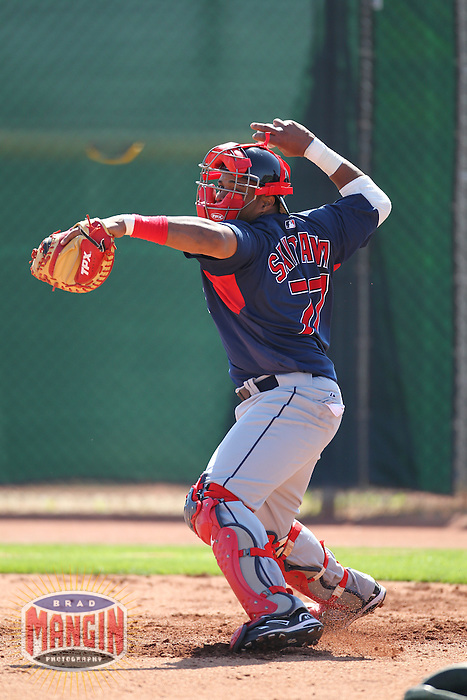 GOODYEAR - MARCH 4:  Rookie catcher Carlos Santana of the Cleveland Indians works out during spring training camp on March 4, 2010 in Goodyear, Arizona. (Photo by Brad Mangin)