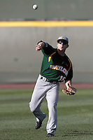 Adam Toth #15 of the Baylor Bears makes a throw against the UCLA Bruins at Jackie Robinson Stadium on February 25, 2012 in Los Angeles,California. UCLA defeated Baylor 9-3.(Larry Goren/Four Seam Images)