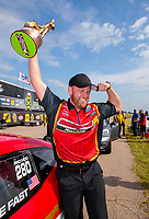 Jun 9, 2019; Topeka, KS, USA; NHRA pro mod driver Steve Jackson celebrates after winning the Heartland Nationals at Heartland Motorsports Park. Mandatory Credit: Mark J. Rebilas-USA TODAY Sports