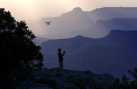 Aug. 22, 2014; GRAND CANYON, AZ, USA; A drone remote controlled helicopter with a GoPro camera attached flies above the south rim of the Grand Canyon at the Grand Canyon National Park. The canyon has been formed over millions of years by the Colorado River cutting its way through the desert. Mandatory Credit: Mark J. Rebilas
