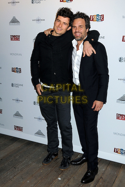 "ORLANDO BLOOM & MARK RUFFALO.""Sympathy for Delicious"" Release Party held at the Mondrian Hotel's SkyBar, .West Hollywood, California, .27th April 2011..full length black white shirt beard facial hair jacket .CAP/ADM/BP.©Byron Purvis/AdMedia/Capital Pictures."
