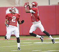 NWA Media/ANDY SHUPE - Arkansas cornerbacks D.J. Dean (2) and Cornelius Floyd work through drills during practice Saturday, Dec. 13, 2014, at the university's practice facility in Fayetteville.