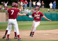 STANFORD, CA - April 23, 2011: Jake Stewart of Stanford baseball celebrates scoring the tying runs with his teammates during Stanford's game against UCLA at Sunken Diamond. Stanford won 5-4.