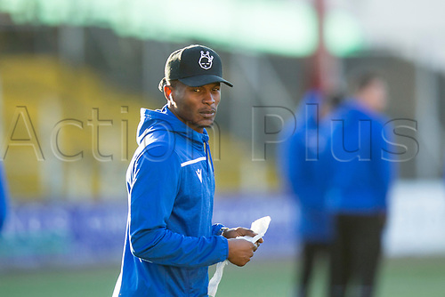 30th November 2019; Dens Park, Dundee, Scotland; Scottish Championship Football, Dundee Football Club versus Queen of the South; Abdul Osman of Queen of the South inspects the pitch before the match - Editorial Use