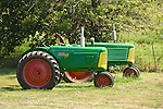 Green, red, yellow Oliver Rowcrop 77 and 66 tractors (late 1950s)