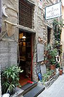 L'entrata dell'osteria  a Cantina de Mananan a Corniglia, uno dei borghi delle Cinque Terre.<br /> The entrance of the restaurant A Cantina de Mananan in Corniglia, at the Cinque Terre.<br /> UPDATE IMAGES PRESS/Riccardo De Luca