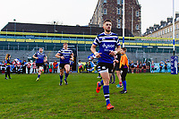 Tom De Glanville and the rest of the Bath United team run onto the field. Premiership Rugby Shield match, between Bath United and Gloucester United on April 8, 2019 at the Recreation Ground in Bath, England. Photo by: Patrick Khachfe / Onside Images