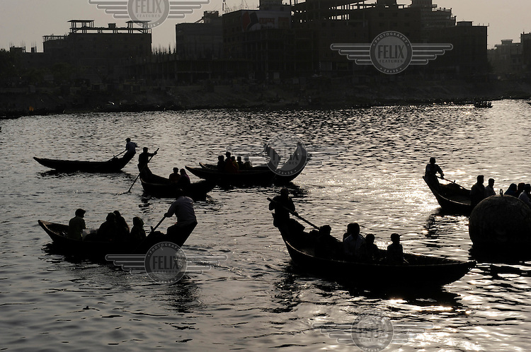 People are ferried over an expanse of water in Dhaka. The city is surrounded by water, making the poorer, low-lying areas susceptible to flooding.