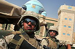 Marins Lcpl. Rodolfo Ruiz, Jr. (l.) and Navy Corpsman Nathan Brindley (r.) ride through the streets of the al-Anbar Province city of Hit, Iraq on Sun. Sept. 18, 2005. i