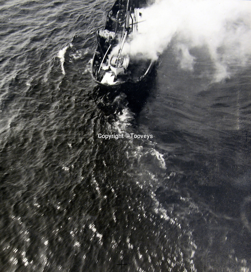 BNPS.co.uk (01202 558833)<br /> Pic:  Tooveys/BNPS<br /> <br /> Taken on 30/07/41 - A direct hit on an enemy merchant vessel.<br /> <br /> Dramatic photos showing a series of heart-pounding World War Two bombing raids from the pilot's perspective have come to light.<br /> <br /> They were taken from Blenheim bombers undertaking attacks on targets in Germany and Nazi-occupied Netherlands in 1941.<br /> <br /> Several capture the immediate aftermath of a direct hit, with flames and clouds of smoke signifying they had achieved their aim.<br /> <br /> The album, which contains almost 100 photos, has emerged for sale with Toovey's Auctions, of Washington, west Sussex.
