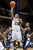January 14, 2012:   Jacksonville Dolphins guard Keith McDougald (20) shoots the ball during Atlantic Sun conference action between the Jacksonville University Dolphins and East Tennessee State University Buccaneers at Veterans Memorial Arena in Jacksonville, Florida.   East Tennessee State defeated Jacksonville 72-58.