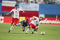 Landon Donovan is sandwiched by two Polish defenders. The USA lost 3-1 against Poland in the FIFA World Cup 2002 in Korea on June 14, 2002.