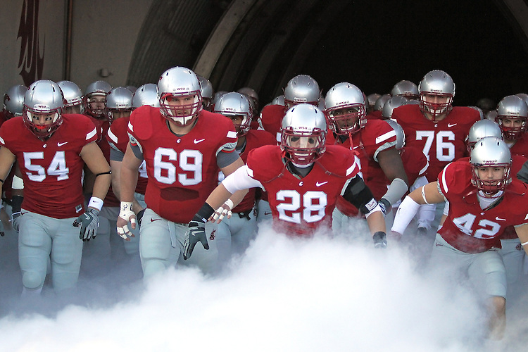 The Washington State Cougar football team comes out of the tunnel at Martin Stadium prior to the start of their Pac-10 conference football game against UCLA on November 14, 2009.