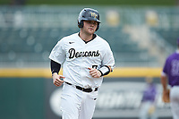 Brendan Tinsman (9) of the Wake Forest Demon Deacons rounds third base during the game against the Furman Paladins at BB&T BallPark on March 2, 2019 in Charlotte, North Carolina. The Demon Deacons defeated the Paladins 13-7. (Brian Westerholt/Four Seam Images)
