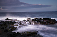 Ocean waves and sunrise. South Point. Hawaii, (The Big Island)
