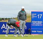 Brian McFadden tidies the detritus from his hotdog for Keith Duffy to tee off during the final round  of the 2016 Aberdeen Asset Management Ladies Scottish Open played at Dundonald Links Ayrshire from 22nd to 24th July 2016:  Picture Stuart Adams, www.golftourimages.com: 22/07/2016