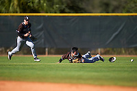 St. Bonaventure Bonnies center fielder Taishi Terashima (1) loses his hat and sunglasses attempting a diving catch as left fielder Sam Fuller backs up the play during a game against the Dartmouth Big Green on February 25, 2017 at North Charlotte Regional Park in Port Charlotte, Florida.  St. Bonaventure defeated Dartmouth 8-7.  (Mike Janes/Four Seam Images)