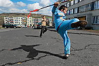 Boys, holding the Easter whips, happily jump in front of an apartment block in the Gipsy ghetto of Chanov, Most, Czech Republic, 26 March 2008.