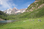 Caucasian hiking group on Sunrise Trail along Maroon Lake below the Maroon Bells, west of Aspen, Colorado, USA