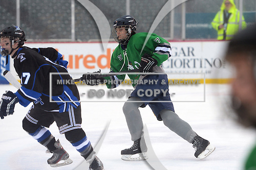 Notre Dame Fighting Irish of Batavia forward Peter Madaferri (27) during a varsity ice hockey game against the Brockport Blue Devils during the Section V Rivalry portion of the Frozen Frontier outdoor hockey event at Frontier Field on December 22, 2013 in Rochester, New York.  (Copyright Mike Janes Photography)