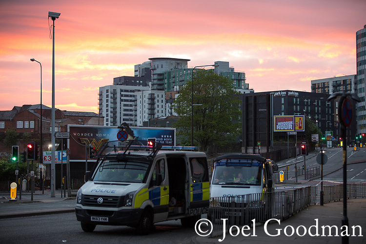 © Joel Goodman - 07973 332324 . 23/05/2017. Manchester, UK. Sunrise as viewed from Trinity Way , opposite the Manchester Arena . Police and other emergency services are seen near the Manchester Arena after reports of an explosion. Police have confirmed they are responding to an incident during an Ariana Grande concert at the venue. Photo credit : Joel Goodman
