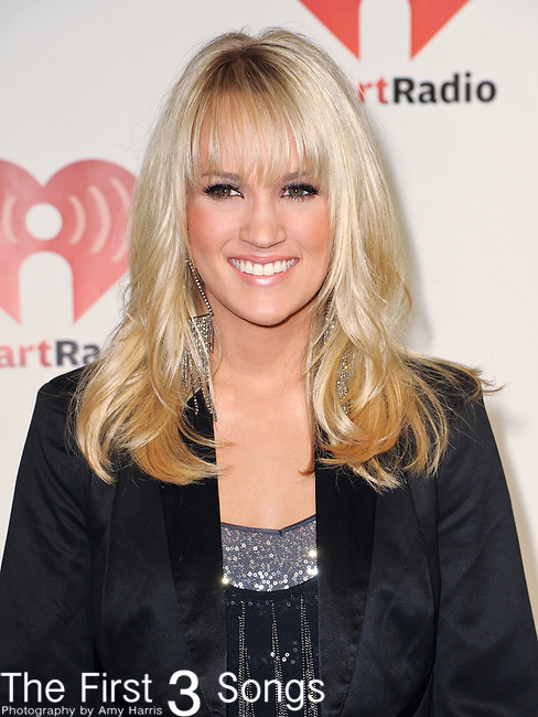 LAS VEGAS - SEPTEMBER 23: Carrie Underwood appears on the red carpet at the 2011 iHeartRadio Music Festival on September 23, 2011 at the MGM Grand Garden Arena in Las Vegas, Nevada.