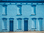 Blue painted brick wall with covered windows, Historic copper mining city of Butte, Montana
