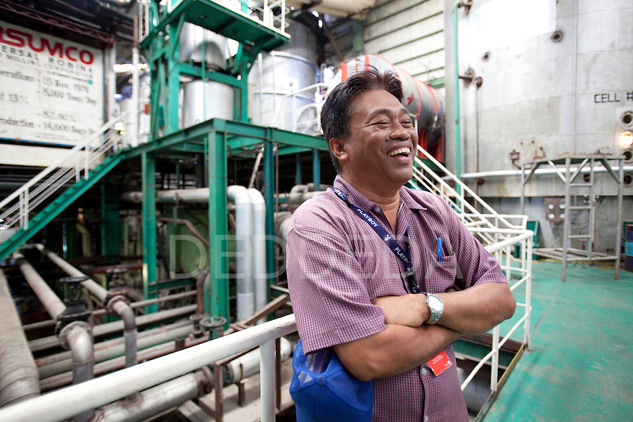 A manager laughs inside the URSUMCO (Universal Robina Sugar Milling Corporation) cane sugar mill near Bias City on Negros Island, Philippines.
