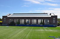 Renovations and Restoration of Coxe Cage, Yale University Athlectics Facility. Project Started May 2013. Construction Progress Photography Submission Ten, 25 September 2013. Project included Skylight replacement, roofing, doors, ventalation systems and track restoration. View from Reese Stadium Bleachers.
