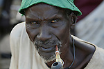An elderly Dinka man smokes a traditional pipe in Rumbek, South Sudan.