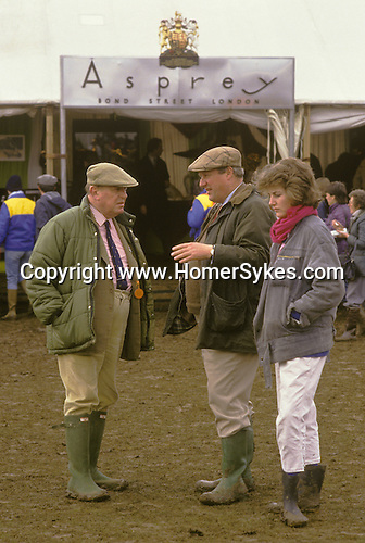 Badminton Horse trials Gloucestershire.  The English Season published by Pavilon Books 1987. Two gents and daughter outside an Aspreys od Bond Street shop.