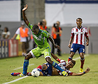 CARSON, CA - August 25, 2012: Seattle defender Jhon Kennedy Hurtado (34) and Chivas midfielder Miller Bolanos (17) during the Chivas USA vs Seattle Sounders match at the Home Depot Center in Carson, California. Final score, Chivas USA 2, Seattle Sounders 6.