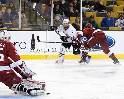 Drew Daniels (NU - 24), Brendan Rempel (Harvard - 42) - The Northeastern University Huskies defeated the Harvard University Crimson 4-1 (EN) on Monday, February 8, 2010, at the TD Garden in Boston, Massachusetts, in the 2010 Beanpot consolation game.