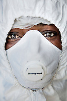 Health workers putting on their Personal Protection Equipment (PPE) before entering The Red Zone at the government run Hasting Treatment Centre.
