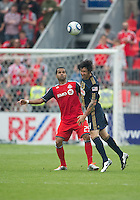 Philadelphia Union defender Danny Califf #4 and Toronto FC forward Maicon Santos #29 in action during an MLS game between the Philadelphia Union and the Toronto FC at BMO Field in Toronto on May 28, 2011..The Philadelphia Union won 6-2..