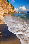 Vieques, Puerto Rico: Black sand beach (Playa Negra) with high sandstone cliffs on the southwest side of the island.