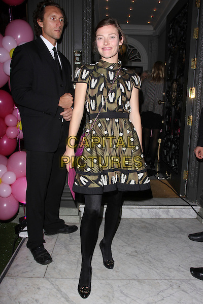 CAMILLA RUTHERFORD .Vogue Fashion's Night Out - Juicy Couture Store, Bruton Street, London, England, UK, September 8th, 2010. .full length black tights green brown print dress khaki high neck .CAP/AH.©Adam Houghton/Capital Pictures.