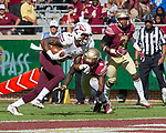Louisiana Monroe wide receiver RJ Turner slips past Florida State's Tararus McFadden (4) ane Derwin James (3) for a touchdown in the 2nd half of an NCAA college football game in Tallahassee, Fla., Saturday, Dec. 2, 2017. Florida State defeated Louisiana Monroe  (AP Photo/Mark Wallheiser)