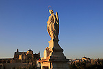 Angel San Rafael statue on Roman bridge  Cordoba, Spain with view towards the cathedral