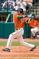Justin Jacobs #21 of the Greensboro Grasshoppers follows through on his swing versus the Kannapolis Intimidators at NewBridge Bank Park June 20, 2009 in Greensboro, North Carolina. (Photo by Brian Westerholt / Four Seam Images)