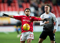 Jay Dasilva of Charlton Athletic battles with Ricky Miller of Peterborough United during the Sky Bet League 1 match between Charlton Athletic and Peterborough at The Valley, London, England on 28 November 2017. Photo by Vince  Mignott / PRiME Media Images.